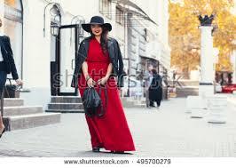 young stylish woman wearing red maxi stock photo 495700279