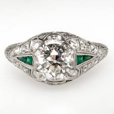 this art deco engagement ring features green glass accents a