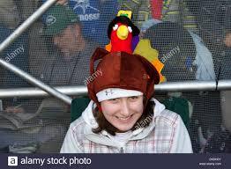 spectator wearing turkey hat at macy s thanksgiving day