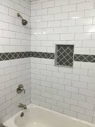 grouting bathtub tile large white subway tile with dark gray grout and gray fleur accent