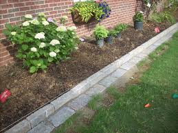 How To Design A Flower Bed Back Yard With Raised Bed Vegetable Garden Plus Wooden Fence Of