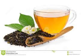 Jasmine Tea Flowers - transparent cup of green tea and jasmine flower isolated stock