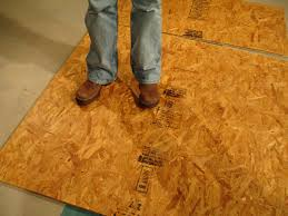 workshop flooring options diy wafer board used to level floor of shop