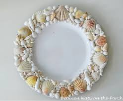 pottery barn shell chargers for a beach themed tablescape knock