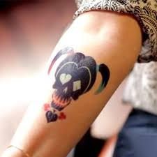 harley quinn skull tattoo on arm