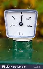 oil tank gauge to meter quantity of fuel empty half full stock