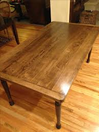 hand crafted solid maple farmhouse dining table with turned legs