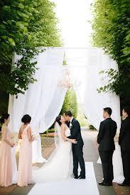 wedding arches chicago blush chandelier chicago botanic garden wedding