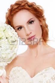 young beautiful redhead bride with clear make up and fancy braids