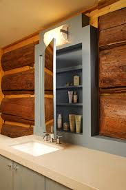log home design interior design mn nc lilu interiors custom light blue medicine cabinet in log home master bath