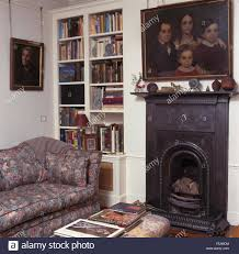 oil painting above small cast iron fireplace i a nineties living