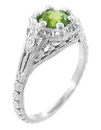 peridot engagement ring filigree flowers deco peridot engagement ring in 14 karat
