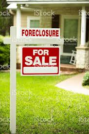 foreclosure house for sale sign front yard of home nobody stock