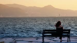 wait bench woman relaxing on bench by the sea stock footage video 4256498