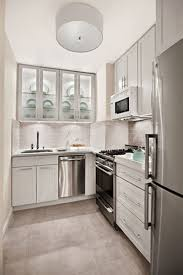 Small Apartment Kitchen Design White Wall Cornered Small Kitchen - Kitchen sink rug