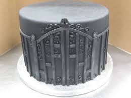 happy halloween birthday pics happy halloween 2014 u2013 spooky wrought iron fence on cake byrdie