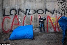 computer graffiti banksy artwork at the calais jungle is defaced with