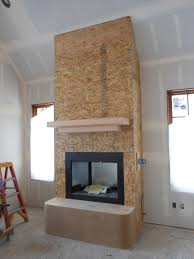 fireplace mantle constructed from doug fir timber osb sheathing