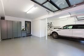 modern two car show garage with epoxy floor frosted glass garage