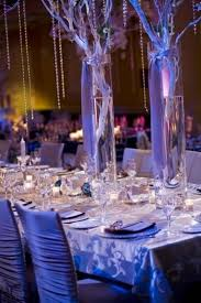 led candles and purple winter wedding table decor
