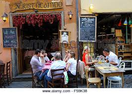 diners enjoying eating outdoors at a small restaurant in