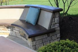 custom concrete seating bench around gas firepit traditional