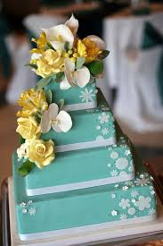 mod square stacked turquoise with yellow flowers cake