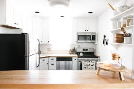 our farmhouse kitchen reno before after farmhouse kitchen subway tile kitchen white and wood kitchen butcher block counter