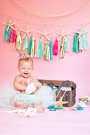 1st birthday party cake smash photo shoot from littlest mermaid 1st birthday party at