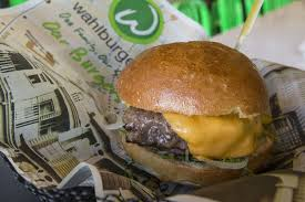 wahlburgers partners up with grocery chain hy vee for 26 new