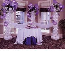 purple balloon and tulle decorated serving area great for
