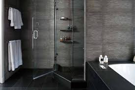 stunning modern bathroom with stainless framed glass enclosure