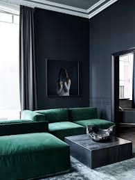 dark walls luxurious living room with dark walls and a deep green velvet sofa