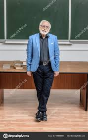 looking with grey hair grey hair professor standing lecture room looking camera stock