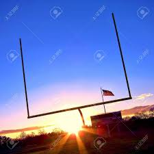 American Flag Sunset American Football Goal Posts At End Zone With Stadium Score Board