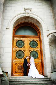 photographers in utah winter wedding at the slc temple spencer and northern