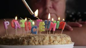 lighted candles on a birthday cake timelapse stock footage video