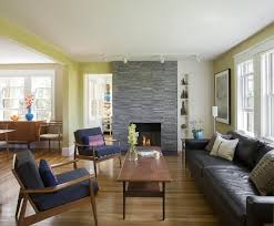 the fireplace wall is made of natural stone cut in irregular shapes built in