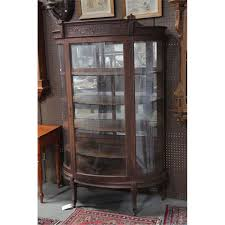 curved glass china cabinet china cabinet oak having a foliate carved crest curved glass door