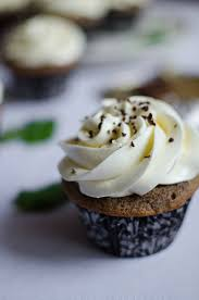 sour cream cupcakes with mint swiss buttercream sprig and flours