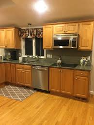 should i paint or stain my oak kitchen cabinets should i paint my oak cabinets or keep them stained