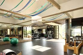 celebrity home gyms dr dre buys gisele bundchen and tom brady la fortress mansion for