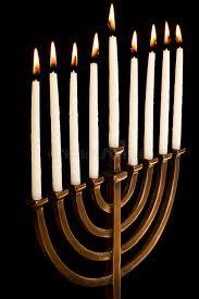 unique menorah beautiful lit hanukkah menorah on black background stock photo