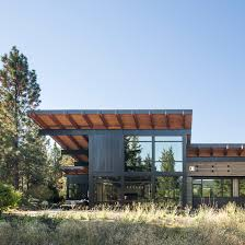 steel beams support dramatic roof overhangs at washington state