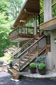 deck stair railing exterior rustic with balcony eaves fish ponds