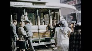 two men rotating cable car on san francisco street 1920s stock