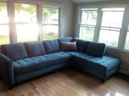 Living Rooms With Blue Couches by Blue Sofa On Wooden Laminate Flooring In Modern Home Living Room