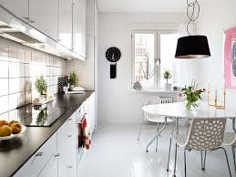 minimalist kitchen design with white gloss cabinet and black