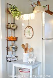organize your kitchen with a wall basket hanger organizing