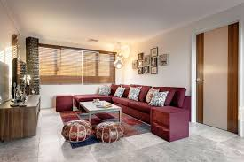 alluring family room with maroon sectional sofa and lovely puffs
